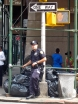I den här stan ser sopgubbarna ut som poliser och poliserna ser ut som sopgubbar. Lite som likheterna mellan sopgubbarna och reseledarna i Sällskapsresan Snowroller.